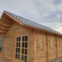 Chalet en bois de 27 m² + 9 m² mezzanine en madriers massifs de 44mm