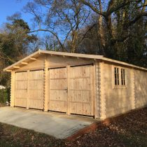 Garage en bois double  en madriers de 44 mm ( 6×6 m) de 36 m²