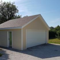 Garage double 0-16 en ossature bois avec bardage vinyl de 40m²