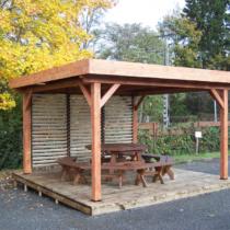 Pergola 9-19 à toit plat de 12m² avec sa couverture bac acier + ventelles mobiles sur 1 côté